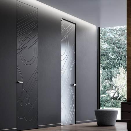 Porte filomuro Door System per un appartamento minimale
